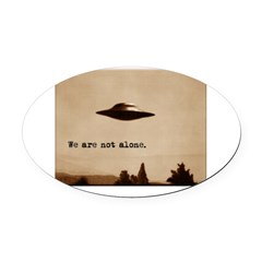 X-Files - We Are Not Alone Oval Car Magnet